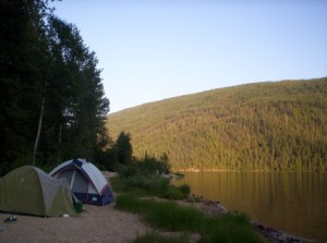 two tents pitched by a lake