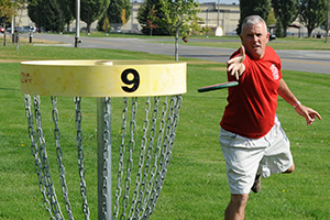 A Disc Golfer Playing Game